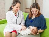 Doctor examining newborn baby with phonendoscope — Stock Photo
