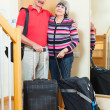 Mature couple with luggage going on holiday — Stock Photo #38555529