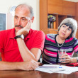 Stock Photo: Mature couple did not have money to repay loan