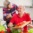 Happy married mature couple cooking together — Stock Photo #38555621