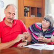 Mature couple having quarrel over financial documents — Stock Photo
