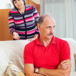 Mature couple after quarrel in living room — Stock Photo #38555659
