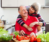 Loving elderly couple cooking together — Stock Photo