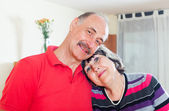 Loving elderly couple in home — Stock Photo