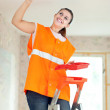 Stock Photo: Female house painter paints ceiling