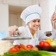 Stock Photo: Happy cook in toque works at kitchen