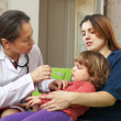 Pediatrician doctor examining baby — Stock Photo