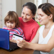 Family doing shopping in internet with credit card — Stock Photo