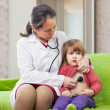 Stock Photo: Doctor examining 2 years baby with stethoscope