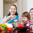Stock Photo: Happy women with child together cooking veggie lunch