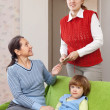 Stock Photo: Mother pays babysitter
