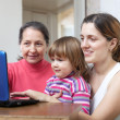 Women of three generations with laptop — Stock Photo #38579501