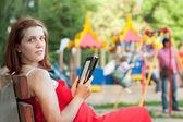 Pregnancy woman reads e-book — Stock Photo