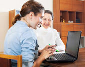 Senior woman answer questions of social worker — Stock Photo