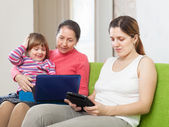 Happy family with electronic devices — Stock Photo
