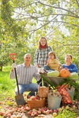 Happy family with in vegetable garden — Stock Photo