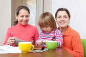Family calculates the family budget at home — Stock Photo