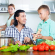Happy family with vegetables — Stock Photo #38693597