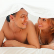 Stock Photo: Couple lying together in bed