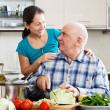 Smiling mature couple cooking food — Stock Photo