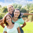 Happy couple with teenage son — Stock Photo #38693663