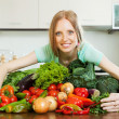 Portrait of woman with heap of vegetables — Stock Photo