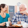 Mature couple having breakfast in morning — Stock Photo
