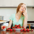 Blonde girl eating strawberry — Stock Photo