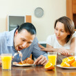 Happy couple having breakfast after night together — Stock Photo