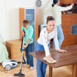 Parents with son dusting together — Stock Photo #38693977