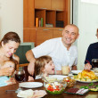 Multigeneration family communicate over holiday table — Stock Photo