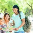 Couple with teenage child traveling together — Stock Photo #38694103