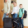 Nice family of two adalts and boy by door going for vac — Stock Photo #38694111