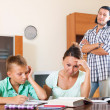 Stock Photo: Ordinary family doing homework