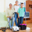 Stock Photo: Ordinary family finished housework