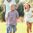 Sporty family of three — Stock Photo #38694289