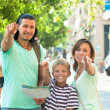 Smiling couple with teenage child traveling together — Stock Photo #38694353
