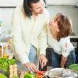 Womand mwith vegetables in kitchen — Stock Photo #38694373