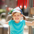 Portrait of laughing three-year girl at playground area — Stock Photo