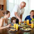 Portrait of happy three generations family posing together over — Stock Photo