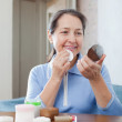 Mature woman cleans the make-up — Stock Photo