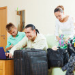 Couple and teenager son going on holiday — Stock Photo