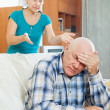 Stock Photo: Upset senior man against angry wife