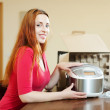 Happy young woman with new multicooker — Стоковое фото