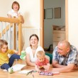 Stock Photo: Portrait of smiling happy three generations family with two chil