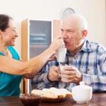 Happy man and woman having tea — Stock Photo