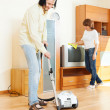 Happy couple doing housework together — Stock Photo #38694857