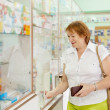 Woman buys drugs at the pharmacy — Stock Photo