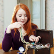 Teen girl looks jewelry in treasure chest — Stock Photo #38694919