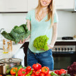 Blonde beautiful housewife with fresh vegetables — Stock Photo